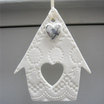 Bird house hanging decoration with blue bird