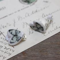 Blue butterfly clip earrings