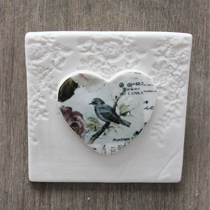 Wall tile hanging with blue bird
