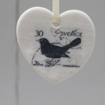 Black bird stamp heart decoration