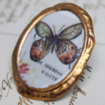 Amber and jade butterfly cameo brooch