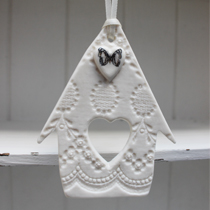 Bird house hanging decoration with black and white butterfly