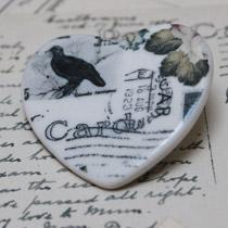Black bird heart brooch