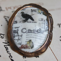 Black bird cameo brooch