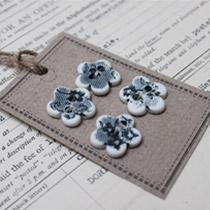 Black and white lace flower buttons