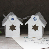 Little bird house with a heart and snowflake imprint