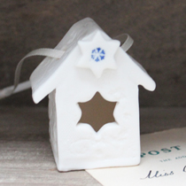 Little bird house with a star and snowflake imprint