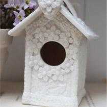 Bird house with flower detail