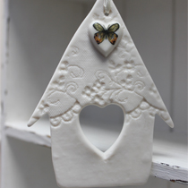 Bird house hanging decoration with green and amber butterfly