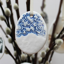 Small blue and white lace egg decoration