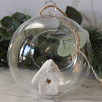 Glass bauble with white house