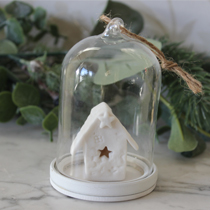 Glass cloche with white house