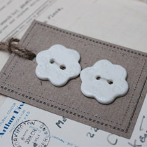 White lace imprinted flower buttons